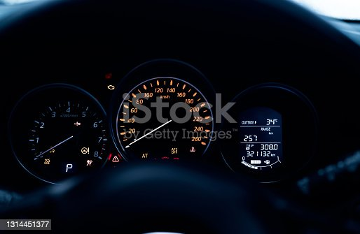 istock Car dashboard interior view. Car instrument panel with tachometer and speedometer. Data information dashboard show gas tank and full battery level icon. rpm gauge and speed meter. Hybrid car dashboard 1314451377