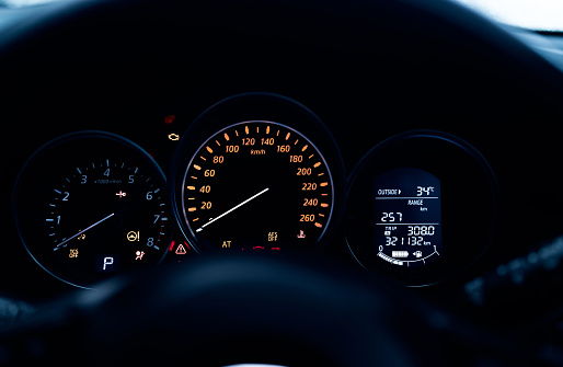 Car dashboard interior view. Car instrument panel with tachometer and speedometer. Data information dashboard show gas tank and full battery level icon. rpm gauge and speed meter. Hybrid car dashboard