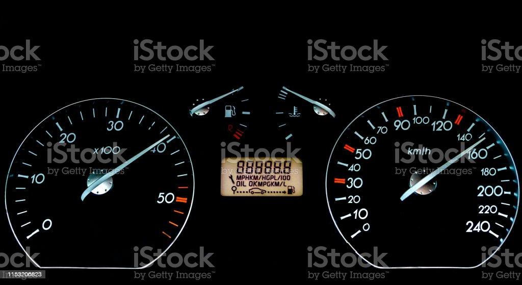 Car dashboard on black surface. Car instrumental panel with warning...