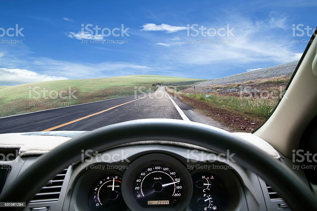 Car dashboard speeds while on the road. car driving fast. stock photo