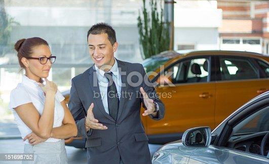 1049198210 istock photo Car dealer. 151698752