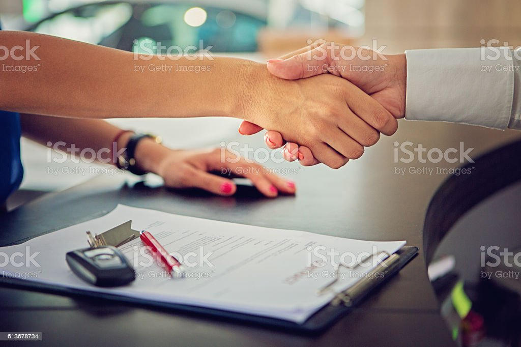 Car dealer sales car to the customer royalty-free stock photo