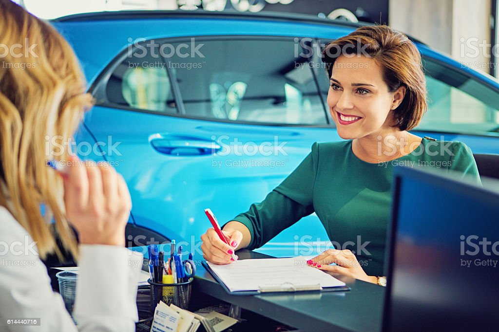 Car dealer sales car to the customer stock photo