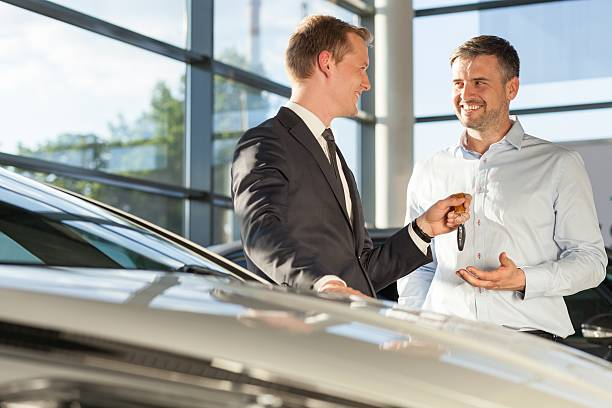 Car dealer selling car stock photo