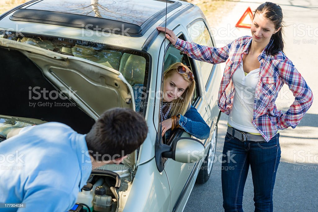 Car defect man helping two female friends royalty-free stock photo