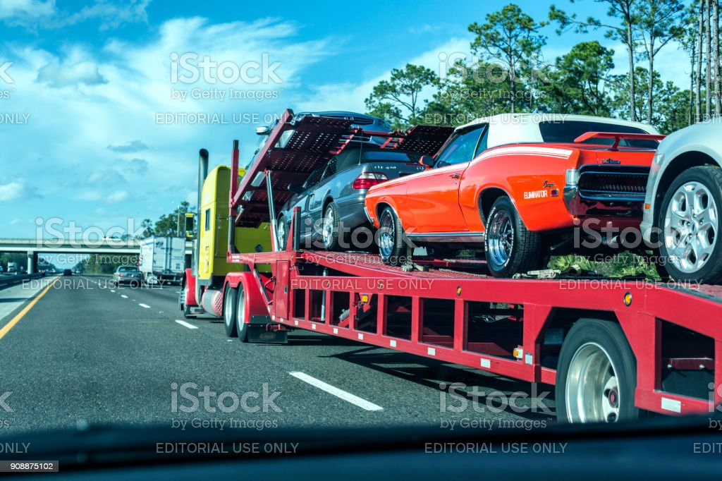 Car Delivery Semi Tractor Trailer Truck on Florida Expressway stock photo