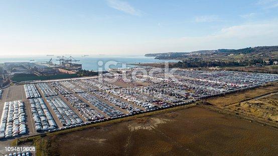 Industrial landscape of car depot near sea harbor