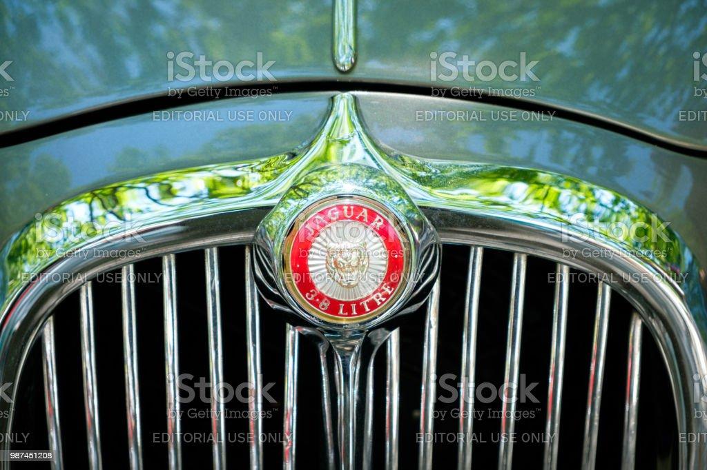 Car Design Detail And Jaguar Logo Brand Name Closeup At Oldtimer