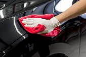 istock Car detailing series : Cleaning black car 534047498