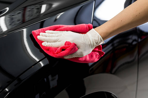 Car detailing series : Cleaning black car stock photo