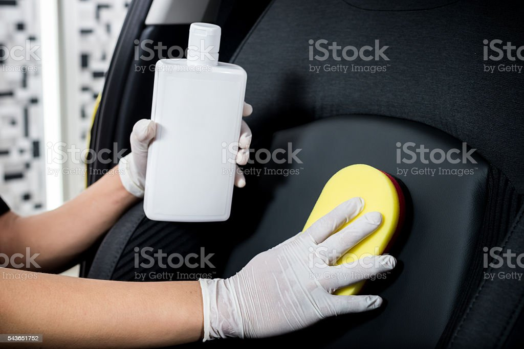 Car detailing series : Cleaning car seat stock photo
