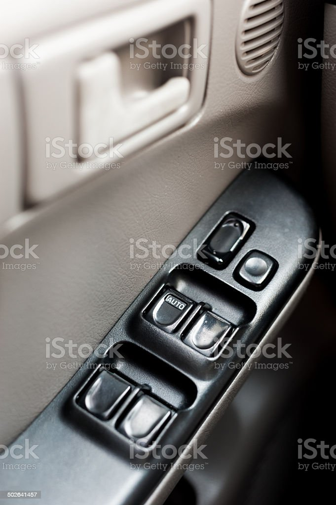 Car door with window control panel on it close-up royalty-free stock photo