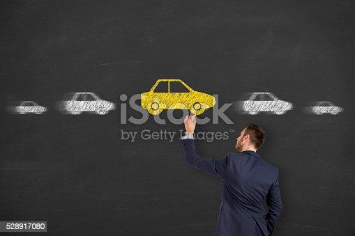 istock Car Drawing on Chalkboard 528917080
