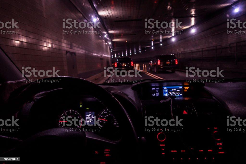 Car Driver POV Following SUV Traffic Through Lincoln Tunnel stock photo