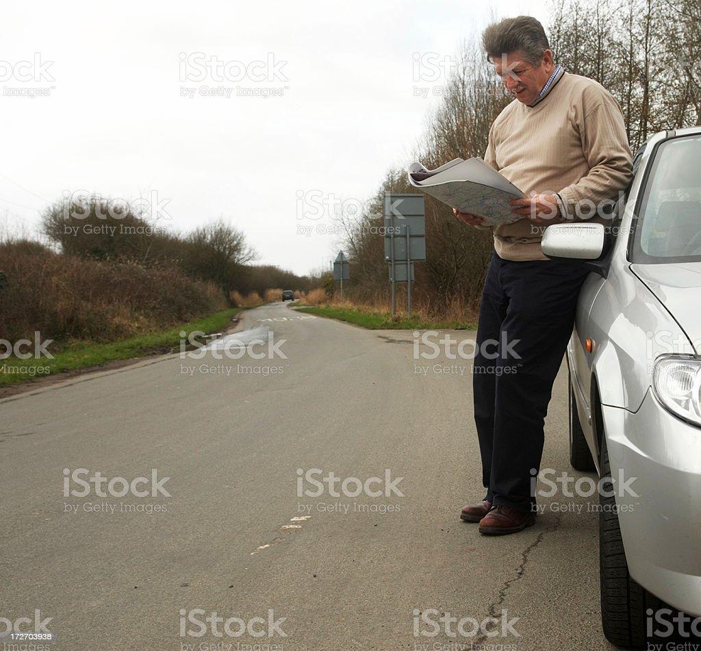 Car driver looking at map royalty-free stock photo