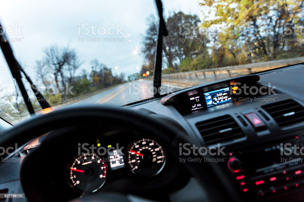 Car Driver POV Perspective Over Steering Wheel and Digital Dashboard stock photo