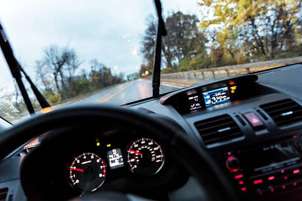 car driver pov perspective over steering wheel and digital dashboard - led uhr stock-fotos und bilder