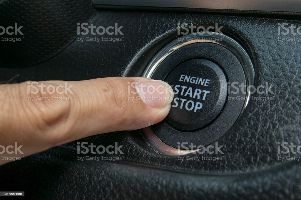 Car driver starting the engine stock photo