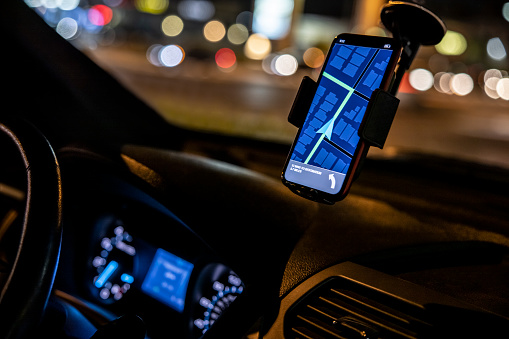Phone based GPS in a car at night.
