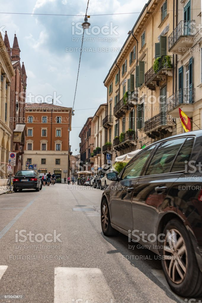 Car drives down a road in central Verona, Italy stock photo