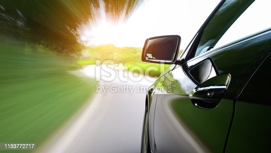 688980174istockphoto Car driving along a country road, blurred motion 1153772717