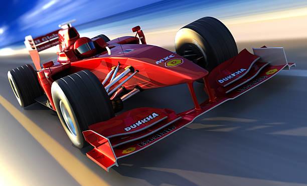 f1 автомобиль вождение вдоль пляжа, обтравка включен - formula 1 стоковые фото и изображения