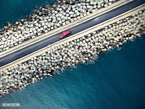 istock Car driving along the coastline 624678238