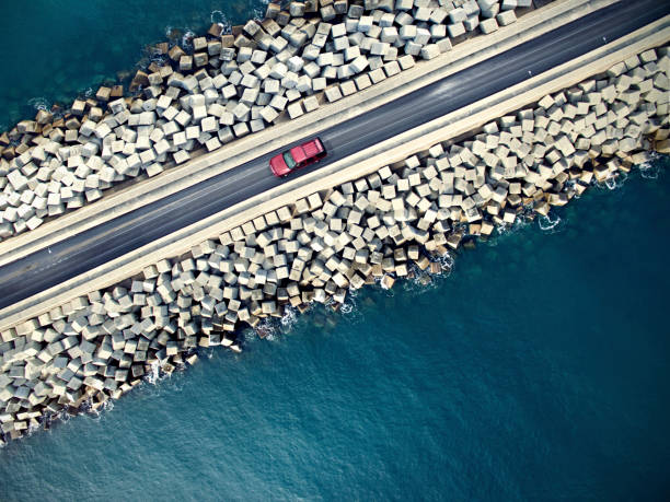 Car driving along the coastline stock photo