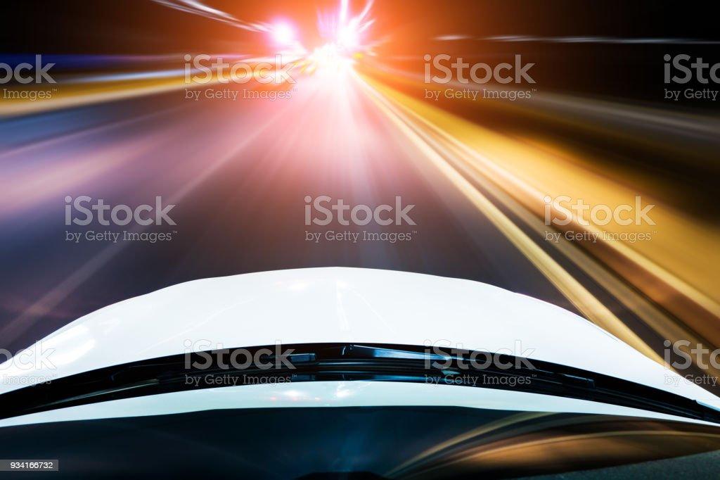 Car driving at night stock photo