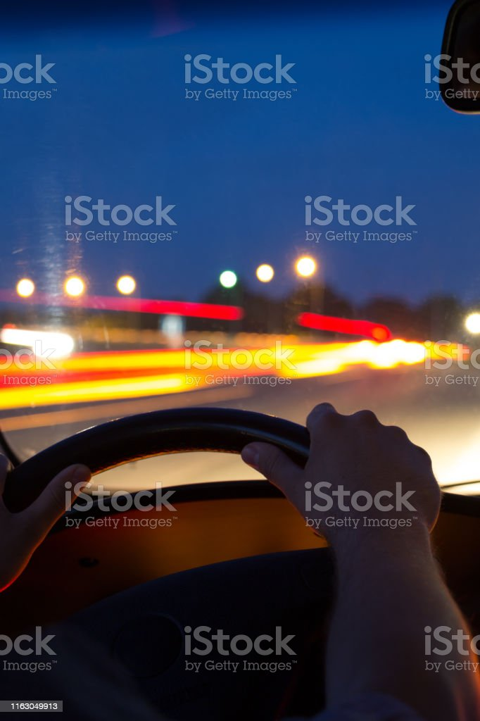 Car Driving At Night View From Inside The Car Mens Hands On Steering Wheel Stock Photo Download Image Now Istock