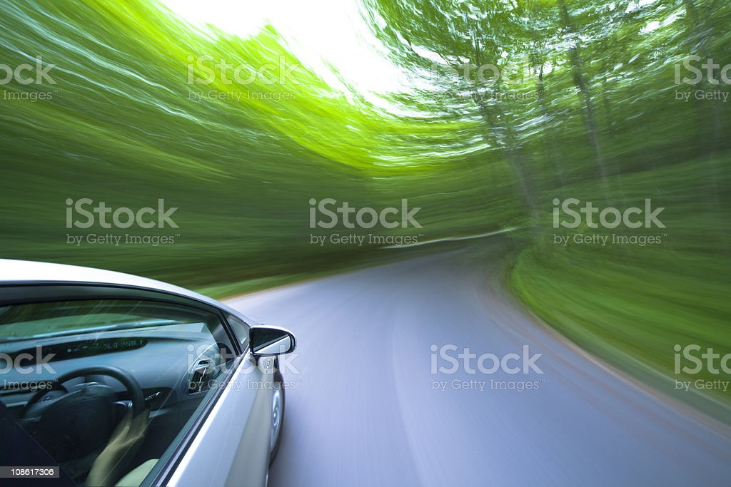 car driving fast into forest. royalty-free stock photo
