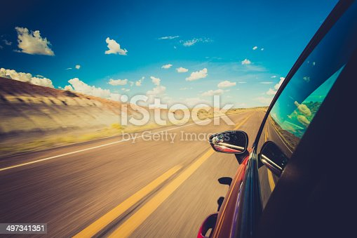 157590217 istock photo Car Driving Fast Motion Blur 497341351