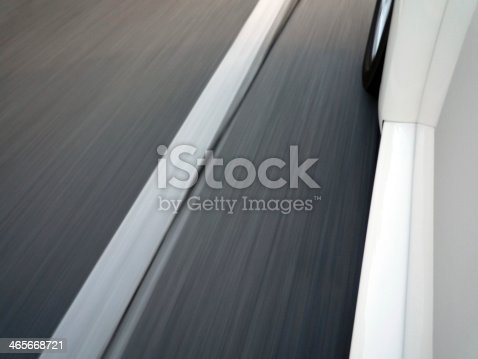 istock Car driving fast 465668721