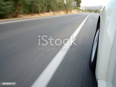 istock Car driving fast 465669167