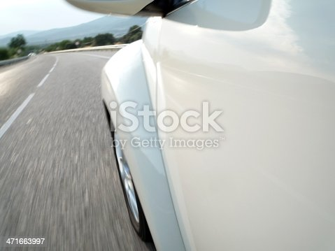 istock Car driving fast 471663997