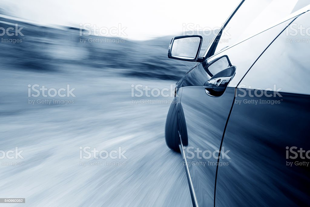 Car driving fast stock photo