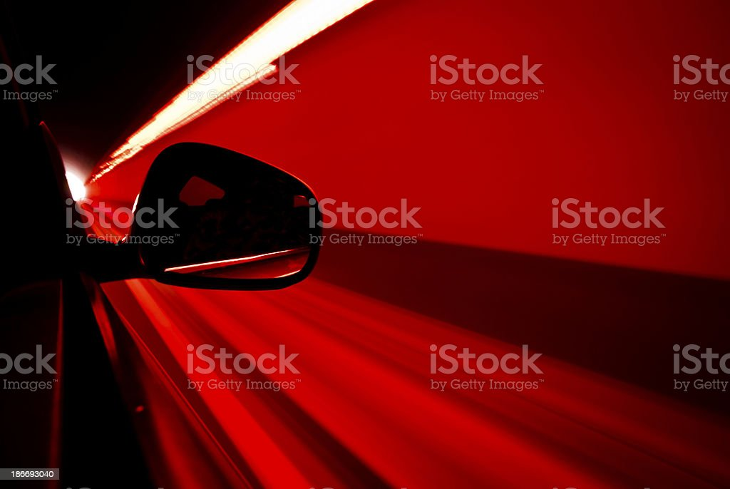Car Driving in a Tunnel by Night Long Exposure stock photo