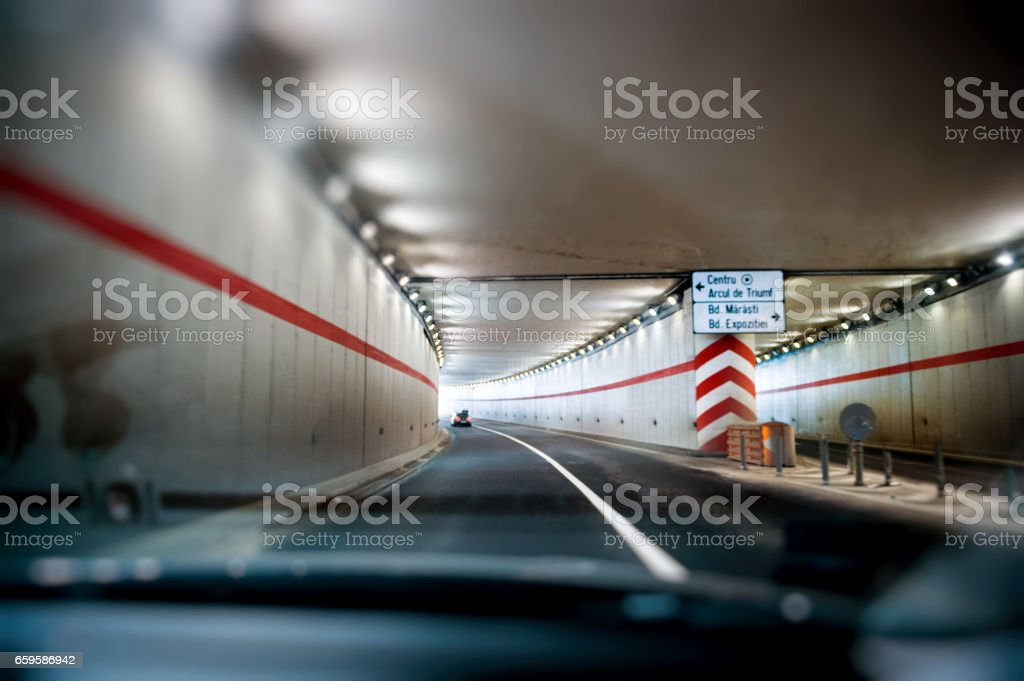 Car driving in Bucharest tunnel stock photo