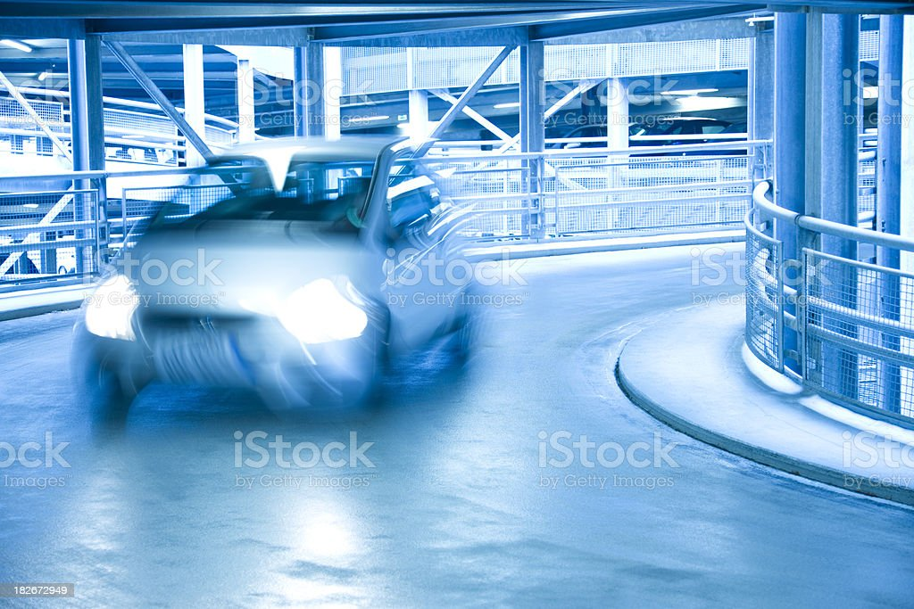 Car driving in parking garage royalty-free stock photo