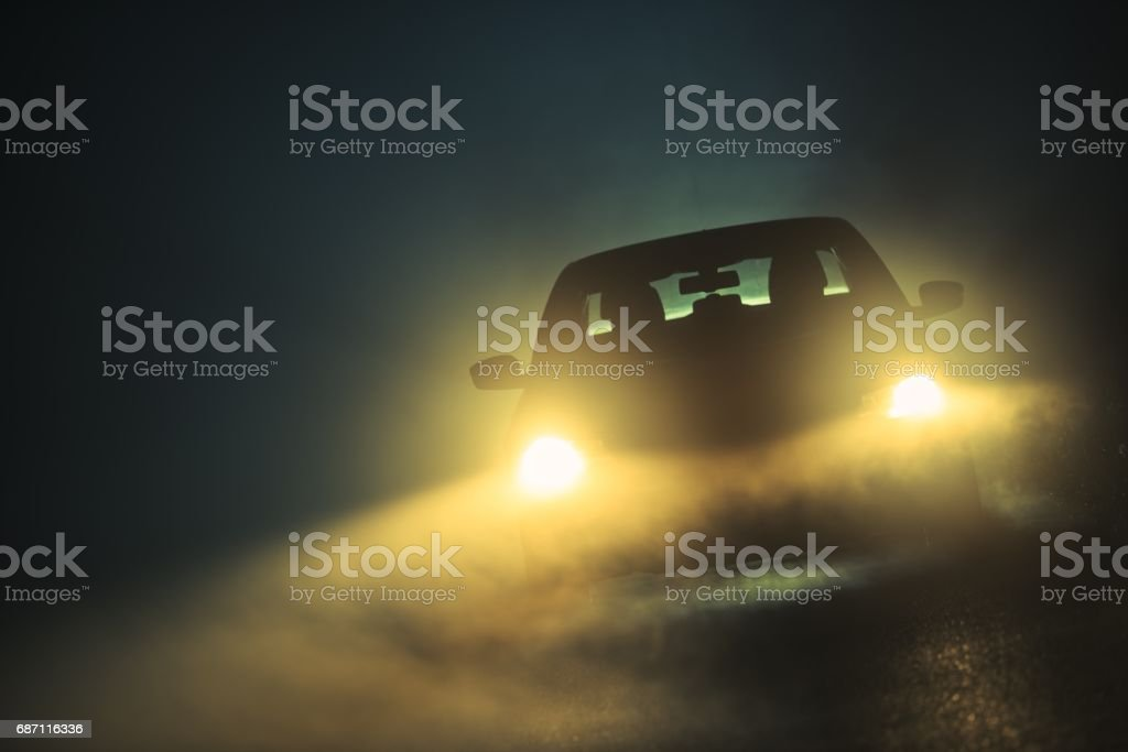 Car Driving in the Fog stock photo