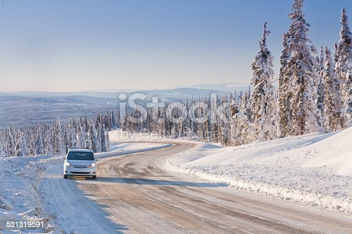 istock Car Driving in the Remote Winter Highway 531319591