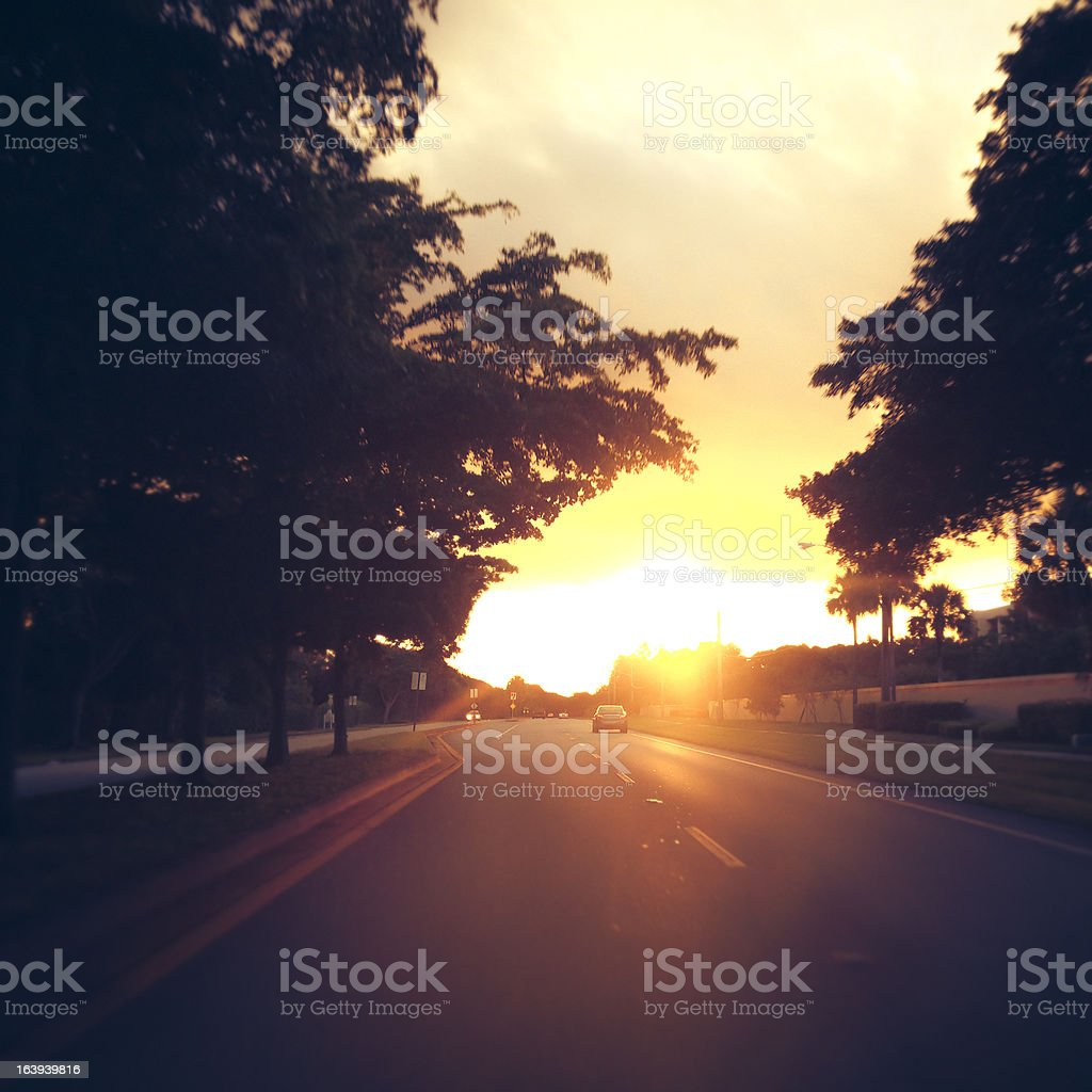 Car Driving Into a Sunset stock photo