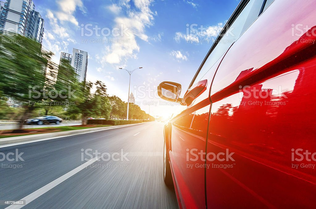 car driving on a motorway at high speeds stock photo