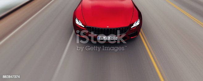 istock car driving on a road by sea 882847374