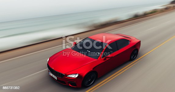 918555756 istock photo car driving on a road by sea 885731352