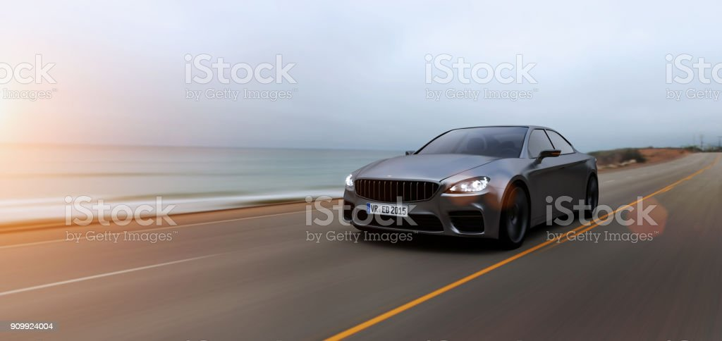 car driving on a road by sea - foto stock