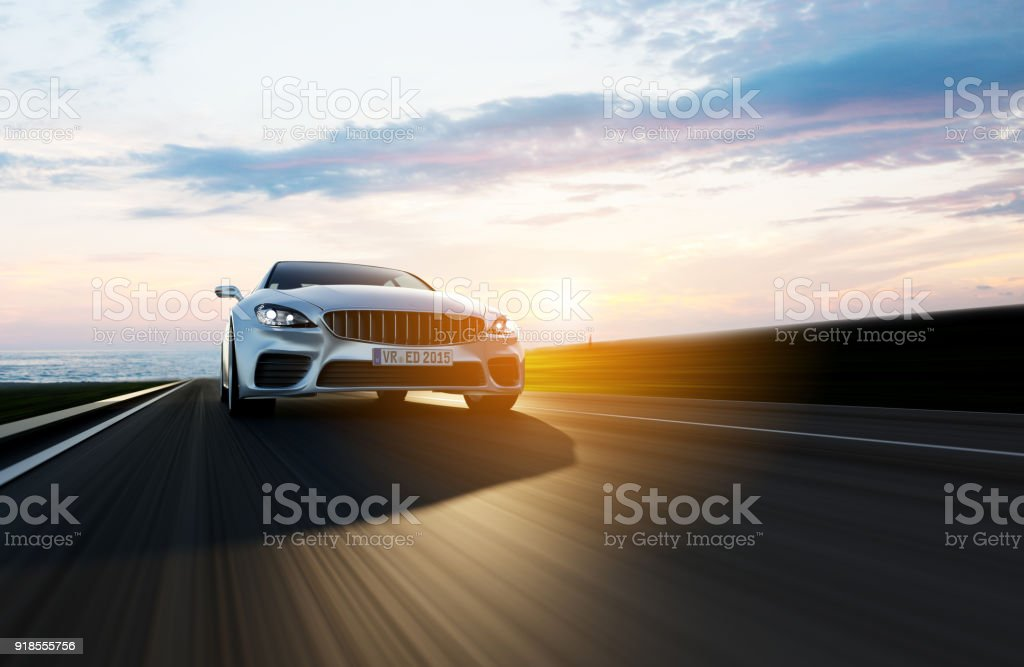 car driving on a road by sea view from side of fast moving car, motion blur,  3D, car of my own design. Asphalt Stock Photo