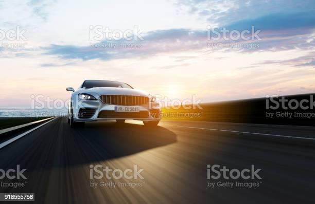 Car driving on a road by sea picture id918555756?b=1&k=6&m=918555756&s=612x612&h=ylet2omjfpcfgicaaf j8epyc1hn6hfdjct25ymel9u=