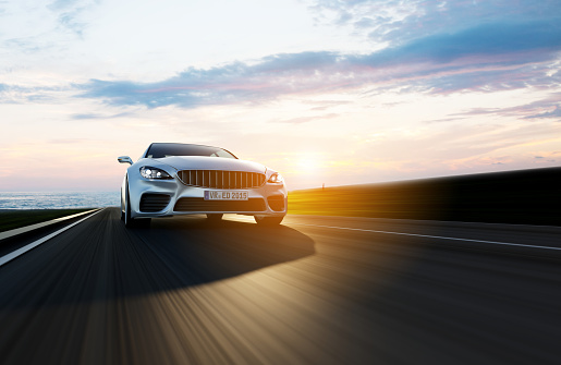 Car Driving On A Road By Sea Stock Photo - Download Image Now