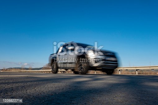 918555756 istock photo Car driving on a road 1225522714